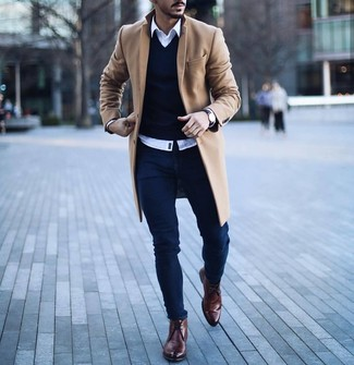 How to wear: camel overcoat, navy v-neck sweater, white long sleeve shirt, navy skinny jeans