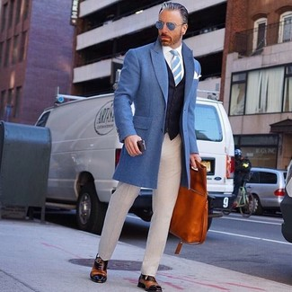 How to wear: blue overcoat, navy waistcoat, white dress shirt, beige dress pants