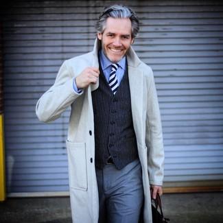 How to wear: grey overcoat, navy vertical striped waistcoat, light blue dress shirt, grey dress pants