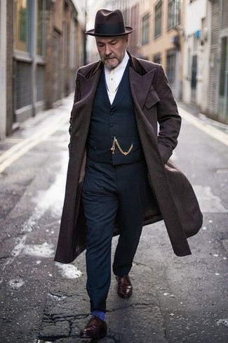 Navy Waistcoat Cold Weather Outfits: Pairing a navy waistcoat and navy dress pants is a guaranteed way to inject your day-to-day wardrobe with some masculine elegance. Finishing off with burgundy leather derby shoes is a surefire way to infuse a more casual aesthetic into this ensemble.