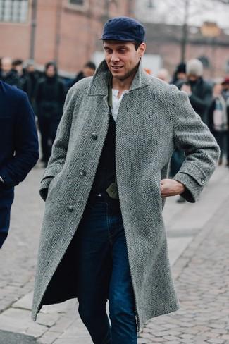 How to wear: grey herringbone overcoat, navy wool waistcoat, white henley shirt, navy jeans