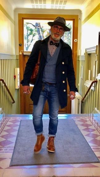 How to wear: black overcoat, navy waistcoat, burgundy gingham long sleeve shirt, blue jeans