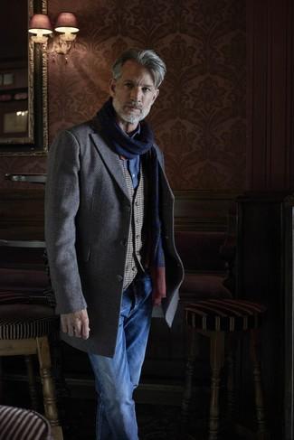 How to wear: grey herringbone overcoat, grey gingham waistcoat, blue chambray long sleeve shirt, blue jeans