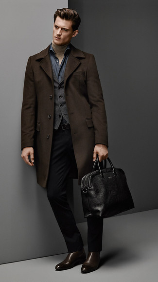 How to wear: dark brown overcoat, charcoal waistcoat, tan turtleneck, navy chambray long sleeve shirt