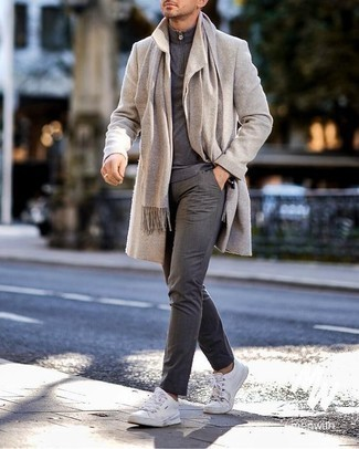 Beige Scarf Outfits For Men: Marrying a beige overcoat with a beige scarf is a smart idea for an off-duty look. Let your styling skills truly shine by completing your outfit with a pair of white leather low top sneakers.