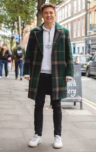 How to Wear Black Jeans For Men: This combination of a dark green plaid overcoat and black jeans is truly a statement-maker. Bring a fun touch to this outfit by sporting white leather low top sneakers.