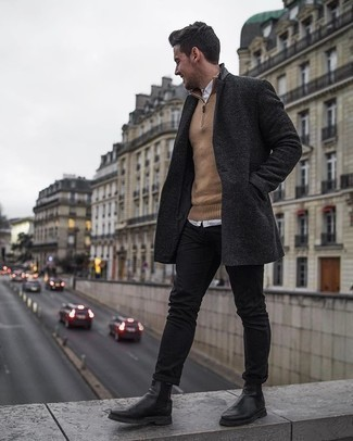 Black Jeans Outfits For Men: This smart combo of a charcoal overcoat and black jeans is super easy to throw together without a second thought, helping you look amazing and ready for anything without spending too much time rummaging through your closet. Bring a more elegant twist to an otherwise mostly dressed-down look with black leather chelsea boots.
