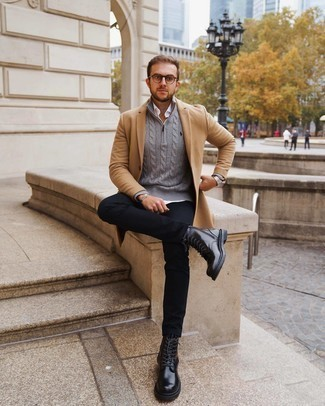 500+ Smart Casual Outfits For Men: This semi-casual combination of a camel overcoat and black chinos is extremely easy to throw together in next to no time, helping you look seriously stylish and ready for anything without spending too much time going through your wardrobe. If in doubt as to the footwear, complement this outfit with a pair of black leather casual boots.