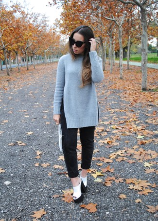 Wear a dark grey knit oversized sweater with black boyfriend jeans for an easy to wear look. A cool pair of monochrome chunky leather heeled sandals is an easy way to upgrade your look.