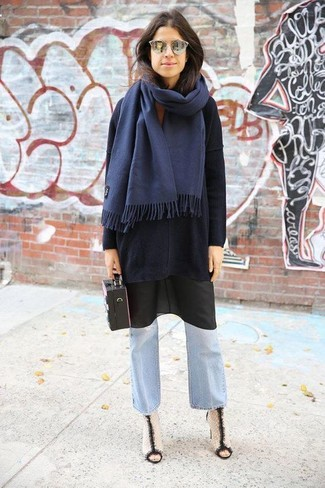How to wear: black oversized sweater, black cami dress, light blue flare jeans, white and black leather ankle boots