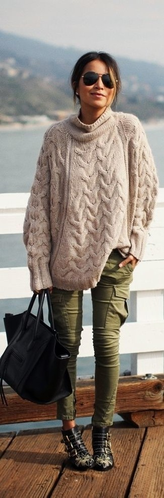 How to wear: beige knit oversized sweater, olive cargo pants, black studded leather ankle boots, black leather tote bag