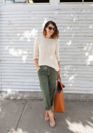 Try teaming a beige oversized sweater with cargo pants for an easy to wear look. Opt for a pair of tan leather mules to va-va-voom your outfit. When it's one of those dreary fall days, sometimes only a neat ensemble like this one can spice it up.