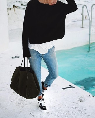 This combo of a black oversized sweater and light blue boyfriend jeans gives off a very casual and approachable vibe. For something more on the daring side to complement this outfit, go for a pair of sneakers. This look is everything for those warmer springtime days.