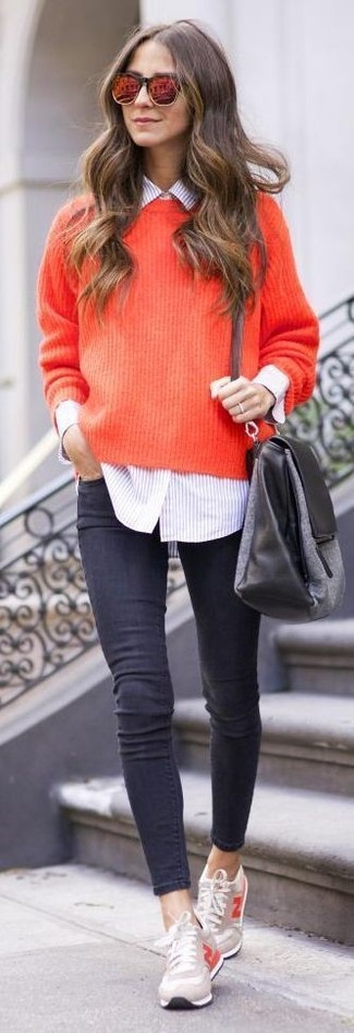 Dress in a red knit oversized sweater and charcoal slim jeans to get a laid-back yet stylish look. Grab a pair of sneakers to loosen things up. This getup is a nice idea come warmer weather.