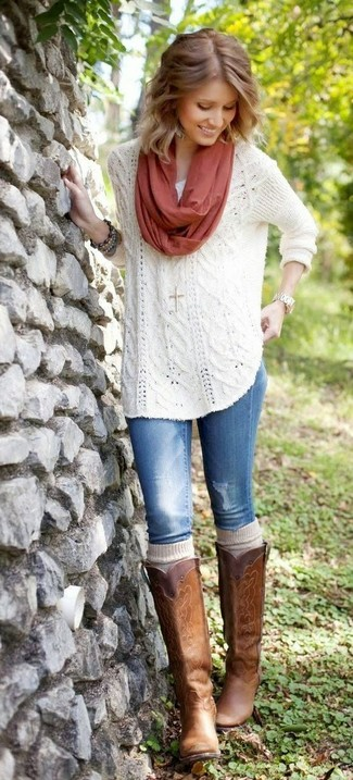 Reach for a white knit oversized sweater and blue jeans for a trendy and easy going look. Brown leather knee high boots will add a touch of polish to an otherwise low-key look.
