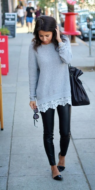 This combo of a dark grey knit oversized sweater and black leather leggings gives off a very casual and approachable vibe. Make black leather ballet flats your footwear choice to instantly up the chic factor of any outfit.