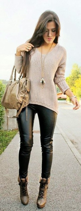 How to wear: beige oversized sweater, black leather leggings, brown leather lace-up ankle boots, tan leather tote bag