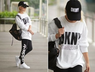 How to wear: white print oversized sweater, black print leggings, white low top sneakers, black leather tote bag