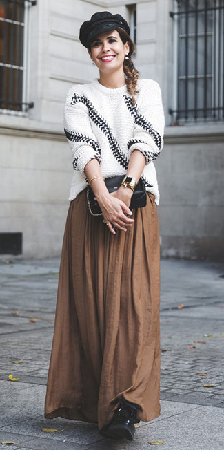 How to wear: white and black knit oversized sweater, brown pleated maxi skirt, black leather lace-up flat boots, black leather crossbody bag