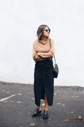 How to Wear a Black Slit Maxi Skirt: If you're after a relaxed and at the same time incredibly stylish getup, team a tan oversized sweater with a black slit maxi skirt. To give your overall outfit a dressier spin, introduce black leather loafers to this getup.