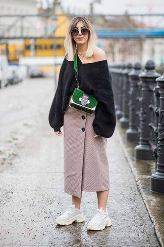 How to wear: black oversized sweater, beige slit midi skirt, white athletic shoes, green suede crossbody bag