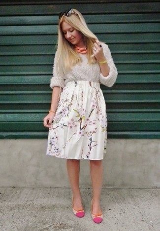 A charcoal knit oversized sweater and a white floral midi skirt are both versatile essentials that will give your outfits a subtle modification. Round off this look with neon pink leather ballerina shoes.