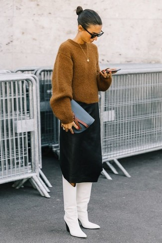 How to wear: tan oversized sweater, black midi skirt, white leather knee high boots, blue leather clutch