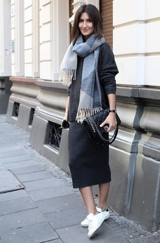 If you're a jeans-and-a-tee kind of gal, you'll like the simple pairing of a charcoal oversized sweater and a grey plaid scarf. Complement this outfit with white and black low top sneakers. As you can see here, this outfit is a really savvy choice, especially for summer-to-fall weather, when the temps are dropping.