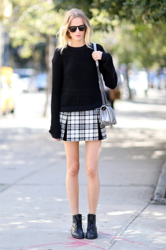 How to wear: black oversized sweater, black and white plaid mini skirt, black leather lace-up flat boots, silver leather crossbody bag