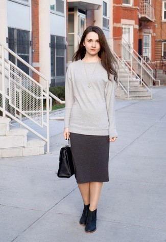 How to wear: grey oversized sweater, charcoal pencil skirt, black leather ankle boots, black leather satchel bag