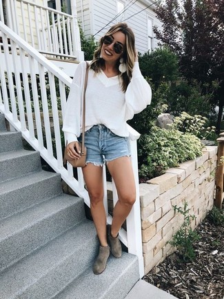 How to wear: white oversized sweater, blue denim shorts, grey suede ankle boots, tan leather crossbody bag
