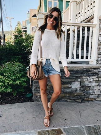 How to wear: white oversized sweater, blue denim shorts, brown leather thong sandals, brown leather crossbody bag