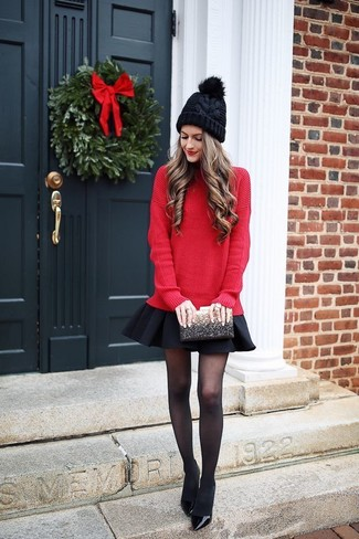 Team a red oversized sweater with a black pleated skirt for a trendy and easy going look. Polish off the ensemble with black leather pumps.