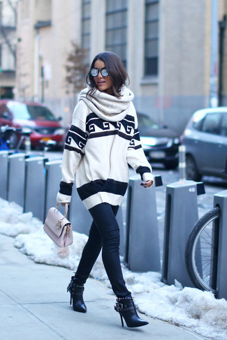 How to wear: white and black print oversized sweater, black skinny jeans, black leather ankle boots, pink leather satchel bag