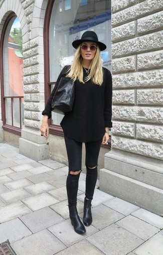 Women's Black Oversized Sweater, Black Ripped Skinny Jeans, Black Leather Ankle Boots, Black Leather Tote Bag