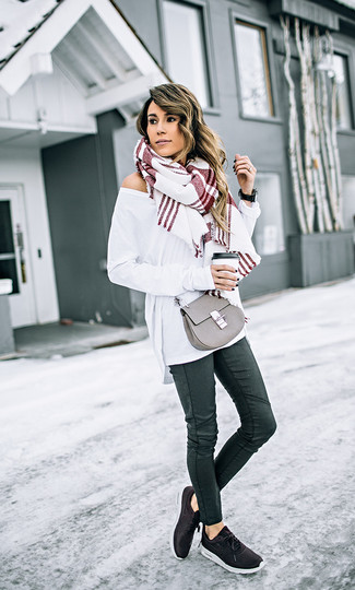 How to Wear a Grey Leather Crossbody Bag: Make a white oversized sweater and a grey leather crossbody bag your outfit choice to assemble an interesting and current off-duty ensemble. Slip into black athletic shoes and you're all set looking smashing.
