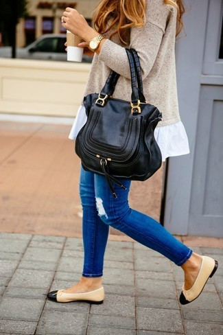 Black Leather Ballerina Shoes Outfits: Marry a beige oversized sweater with blue ripped skinny jeans for a seriously stylish getup that's also easy to wear. Take an otherwise mostly dressed-down ensemble a dressier path by finishing off with a pair of black leather ballerina shoes.