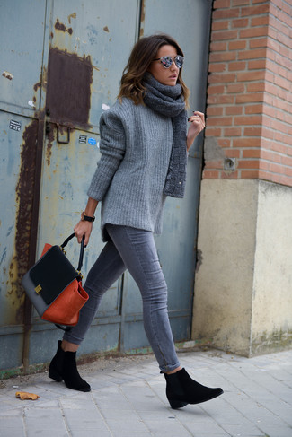 Stay stylish on busy days in a grey knit oversized sweater and a grey knit scarf. A pair of black suede chelsea boots will add some real flair to this outfit. This ensemble is the definition of perfect for when leaves change color and autumn is in full swing.