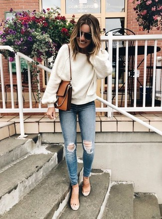How to wear: white oversized sweater, blue ripped skinny jeans, tan leather heeled sandals, brown leather crossbody bag
