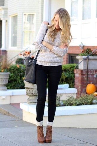 How to wear: grey oversized sweater, black skinny jeans, brown leather lace-up ankle boots, white knee high socks