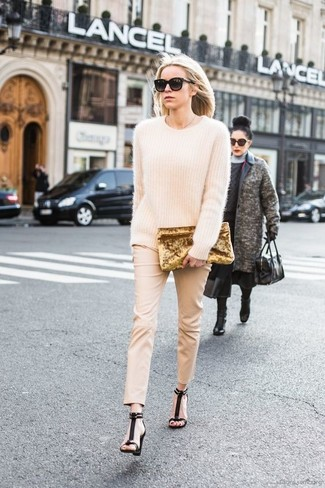 Wear a beige mohair oversized sweater and beige skinny pants to achieve a chic look. Dress up this outfit with black suede heeled sandals. This getup is the definition of perfect for when temps are getting lower and autumn is in full swing.