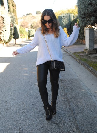 Light Blue Knit Oversized Sweater Outfits: Fashionable and functional, this pairing of a light blue knit oversized sweater and black leather skinny pants provides with variety. Black leather lace-up ankle boots will bring a touch of sultry class to your outfit.