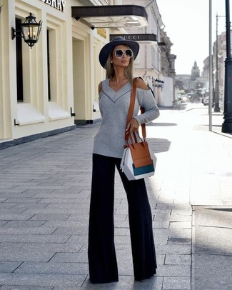 How to wear: grey cutout oversized sweater, black wide leg pants, brown leather crossbody bag, charcoal wool hat