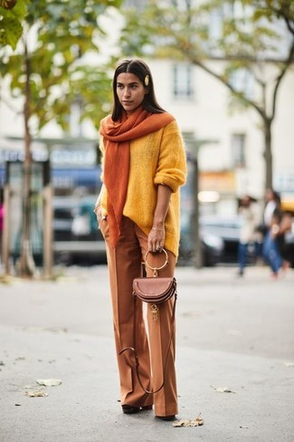 How to Wear a Gold Scarf For Women: We all seek practicality when it comes to fashion, and this pairing of a yellow oversized sweater and a gold scarf is a practical illustration of that. And if you wish to easily level up this getup with shoes, add a pair of brown chunky suede pumps to your outfit.