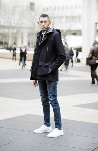 How to Wear a Navy Parka For Men: Pair a navy parka with blue jeans, if you enjoy relaxed dressing but also want to look stylish. Add a pair of white canvas low top sneakers to the equation and the whole outfit will come together wonderfully.