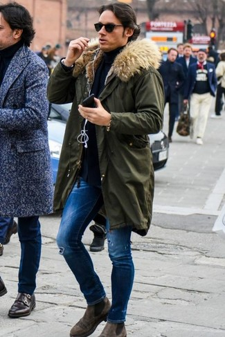 How to Wear Blue Ripped Skinny Jeans For Men: For a relaxed casual getup, reach for a dark green parka and blue ripped skinny jeans — these two pieces work really well together. Add a pair of brown suede chelsea boots to the mix to easily bump up the classy factor of your outfit.