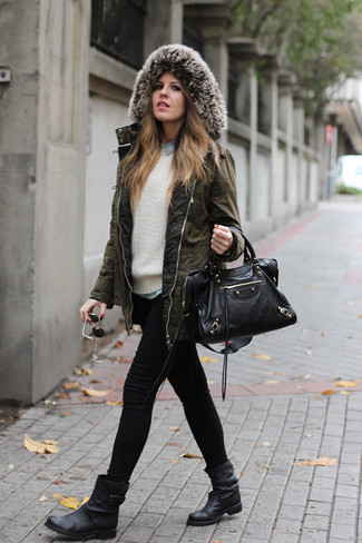 Rock a white cable sweater with black skinny jeans for a standout ensemble. Got bored with this outfit? Enter black leather ankle boots to change things up a bit. Now that's perfect winter outfit.