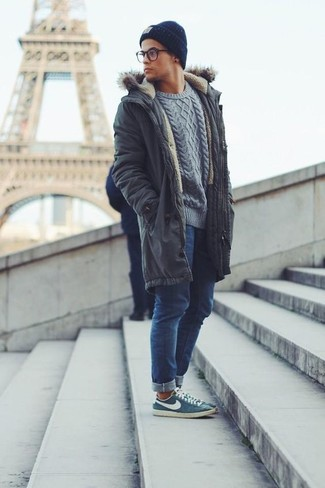 Keep your outfit laid-back in a charcoal parka and a navy beanie. Blue low top sneakers will bring a classic aesthetic to the ensemble. If you're already bored of your fall fashion options, this outfit just might be the inspiration you need.