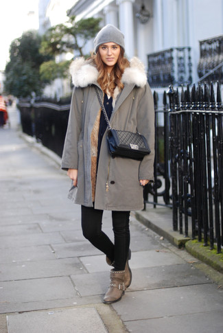 Wear a grey parka and black slim jeans for a refined yet off-duty ensemble. Dress up this look with brown leather ankle boots. You can see that just because it's below zero outside doesn't mean your getups can't be both warm and beyond chic.