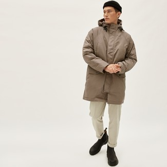 1152+ Winter Outfits For Men: Extremely stylish and practical, this casual combination of a tan parka and beige chinos provides with variety. Dark brown leather chelsea boots are an effortless way to power up this getup. This combination is truly a lesson in how to dress for winter.